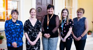 Left to right: Deputy Home Manager Katrina Karolchyk, Senior Shift Leader Mystral Martin, Home Manager Aggie McDonald, Business Relationship Manager Jade Gibson, and Activities Coordinator Annie Price
