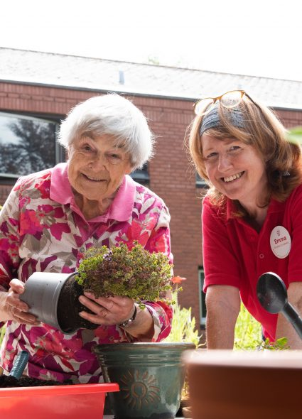 Resident and staff member gardening at Cadogan Court, Exeter.