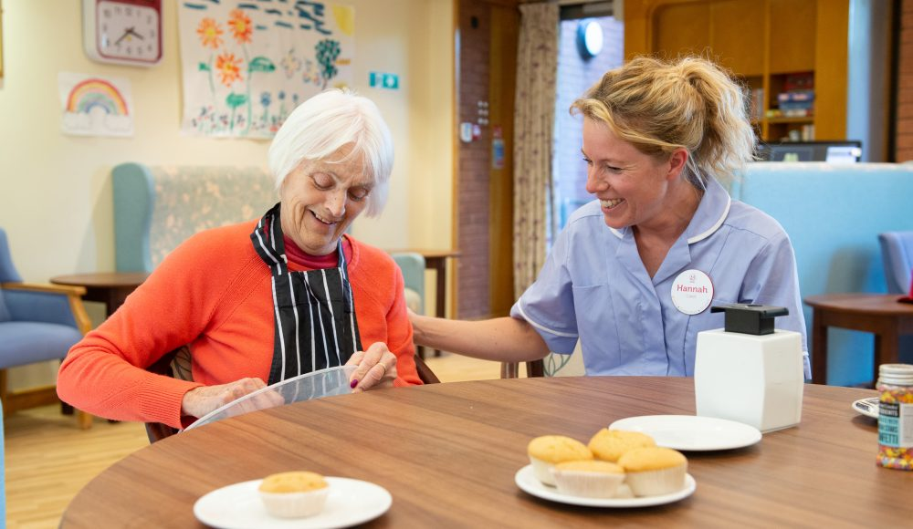 Resident and staff member baking at Cadogan Court, Exeter.
