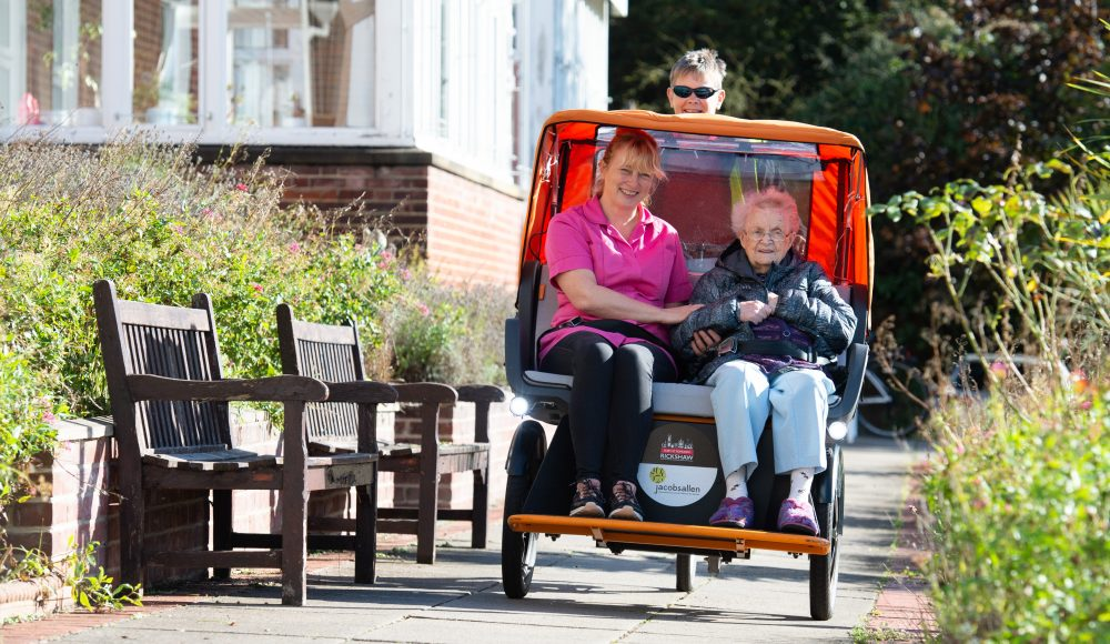 Resident on tricycle at Cornwallis Court