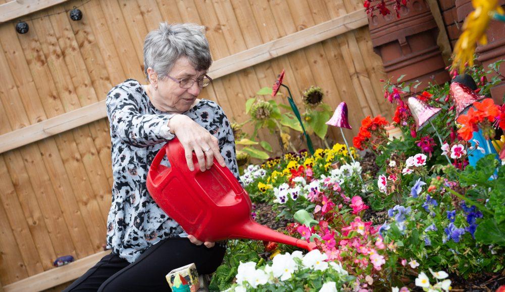 Resident gardening at Harry Priestley House