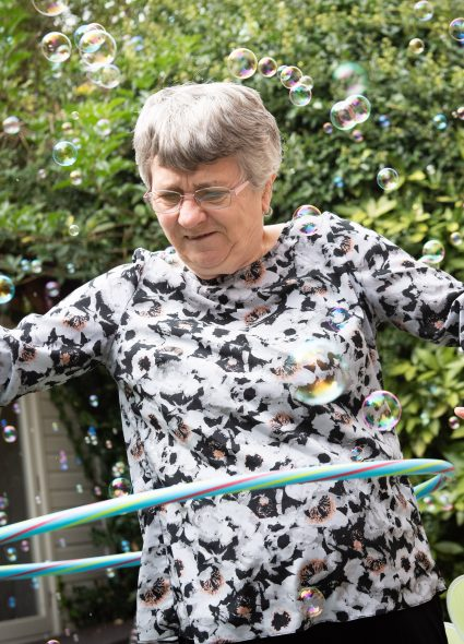 Resident doing the hula at Harry Priestley House