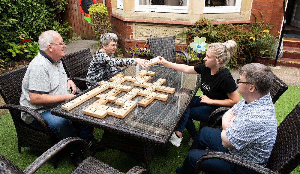 Residents playing giant dominos at Harry Priestley House