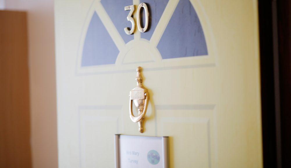 Bedroom door at Prince George Duke of Kent Court