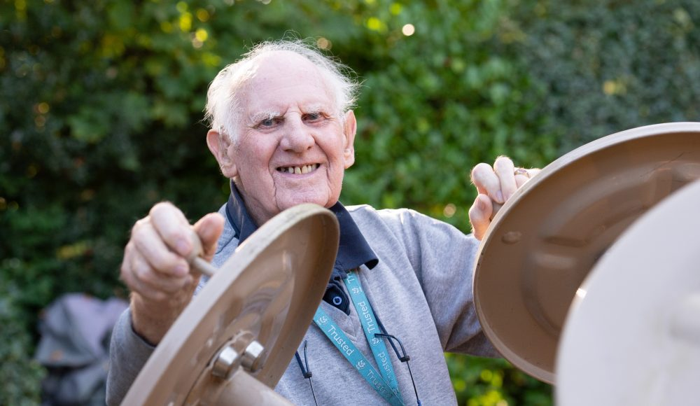 Resident exercising outdoors at Prince Michael of Kent Court