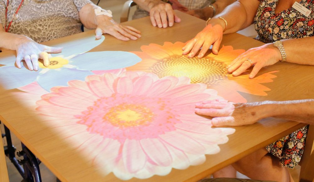 Residents using magic table technology at Queen Elizabeth Court