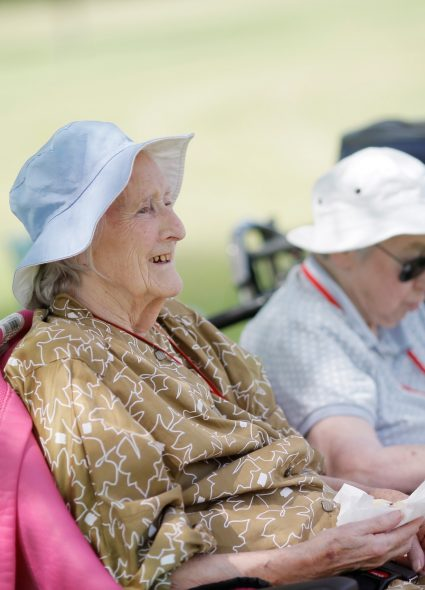 Residents enjoying outdoors at Queen Elizabeth Court