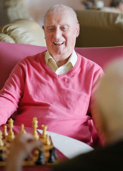 Residents playing chess at Scarbrough Court
