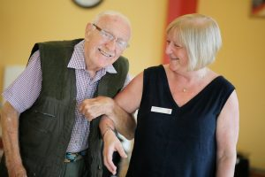 Resident John and staff member Seila at Scarbourgh Court