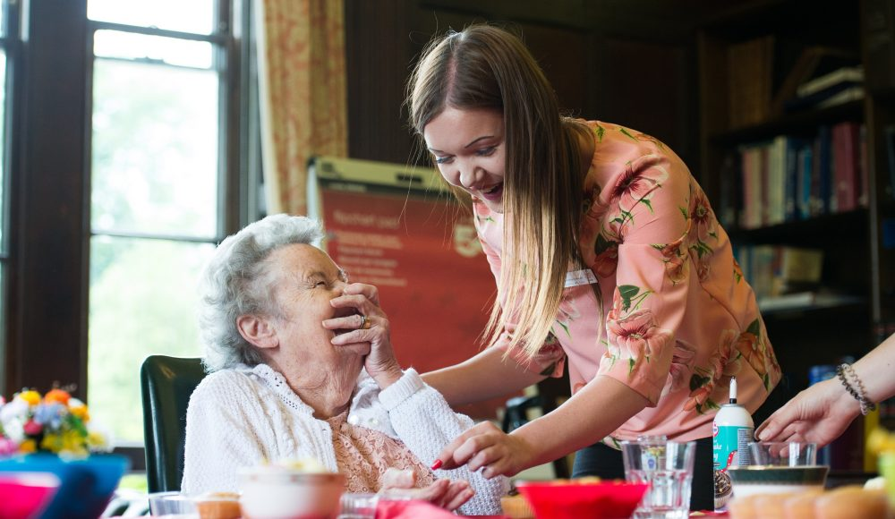Resident and staff at Prince Edward Duke of Kent Court making cupcakes