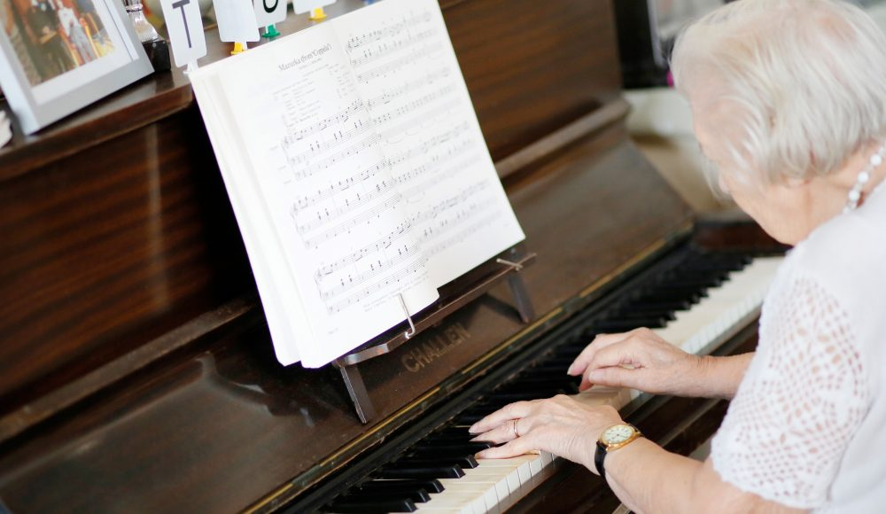 Resident playing piano at The Tithebarn