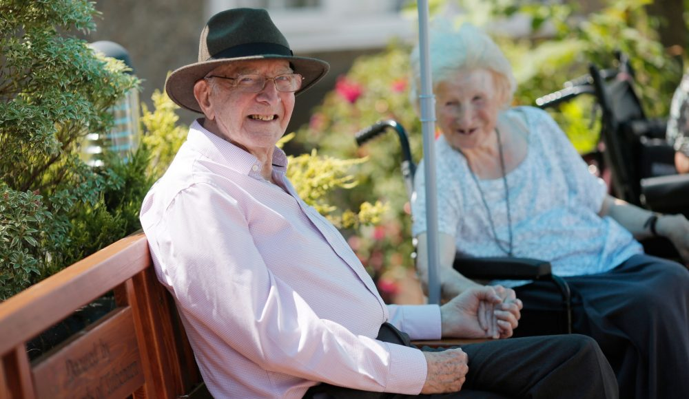 Residents enjoying the garden at The Tithebarn