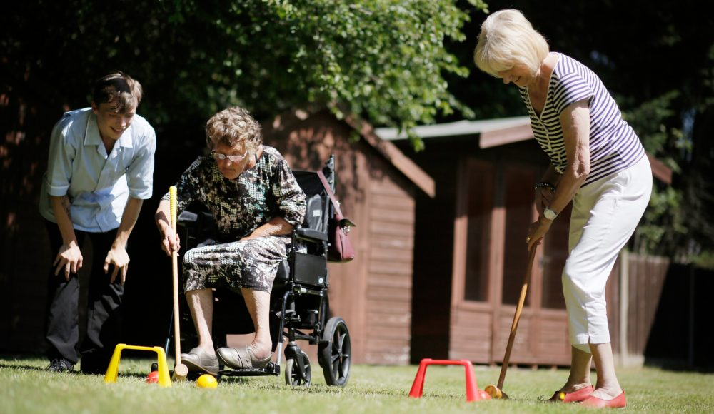 Residents playing croquet at The Tithebarn
