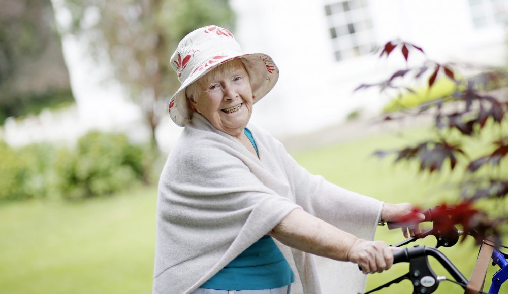 Resident walking in the gardens at Shannon Court