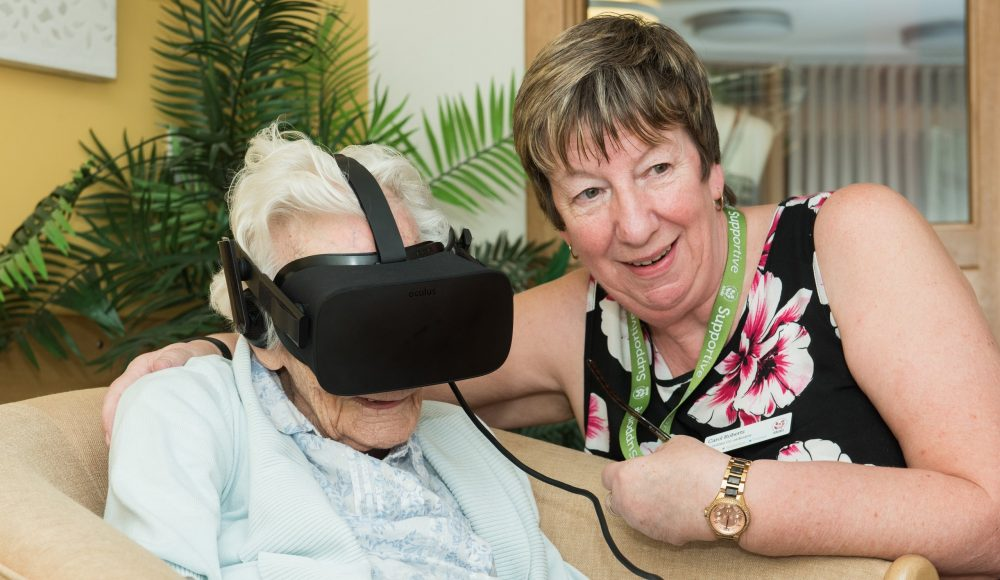 Resident and staff member using Virtual Reality at James Terry Court