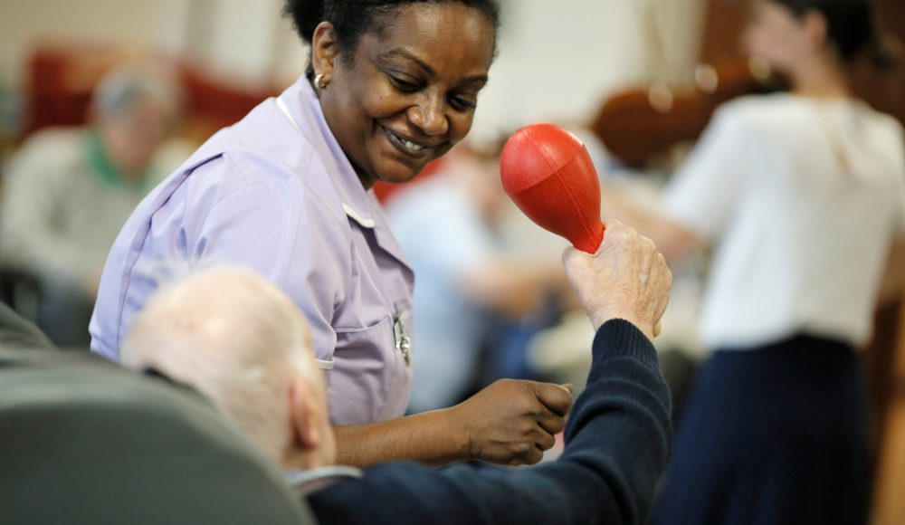 Resident and staff member at Prince George Duke of Kent Court