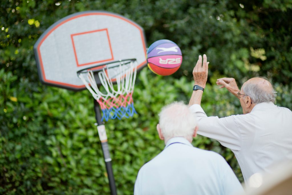 Residents playing basketball at Prince Michael of Kent Court
