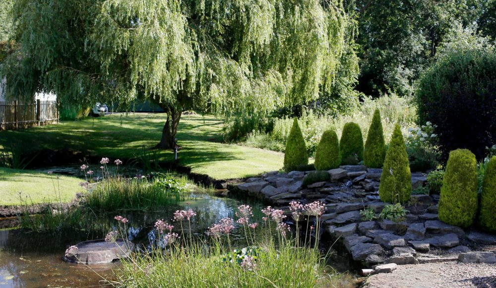 Pond and gardens at The Tithebarn