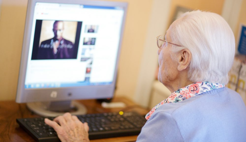 Resident using computer at Zetland Court