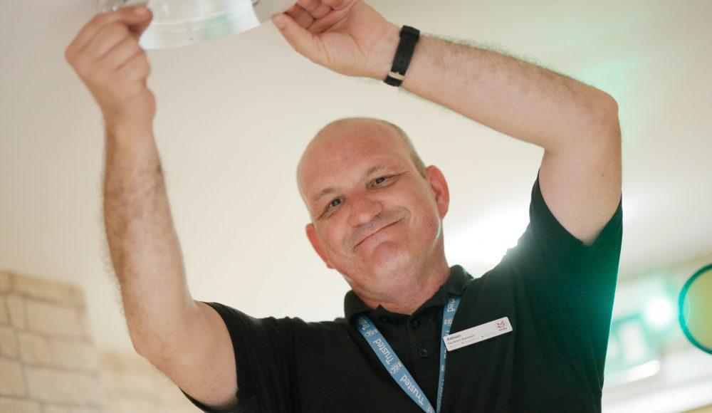 Facilities staff member fixing lights at Ecclesholme