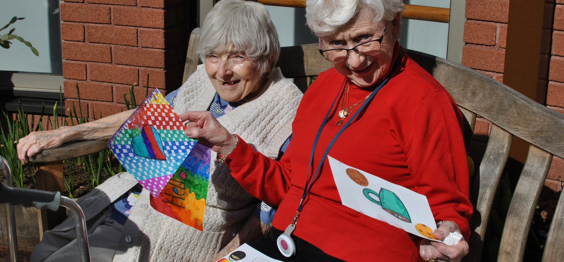 Residents read messages from the local community at Cadogan Court