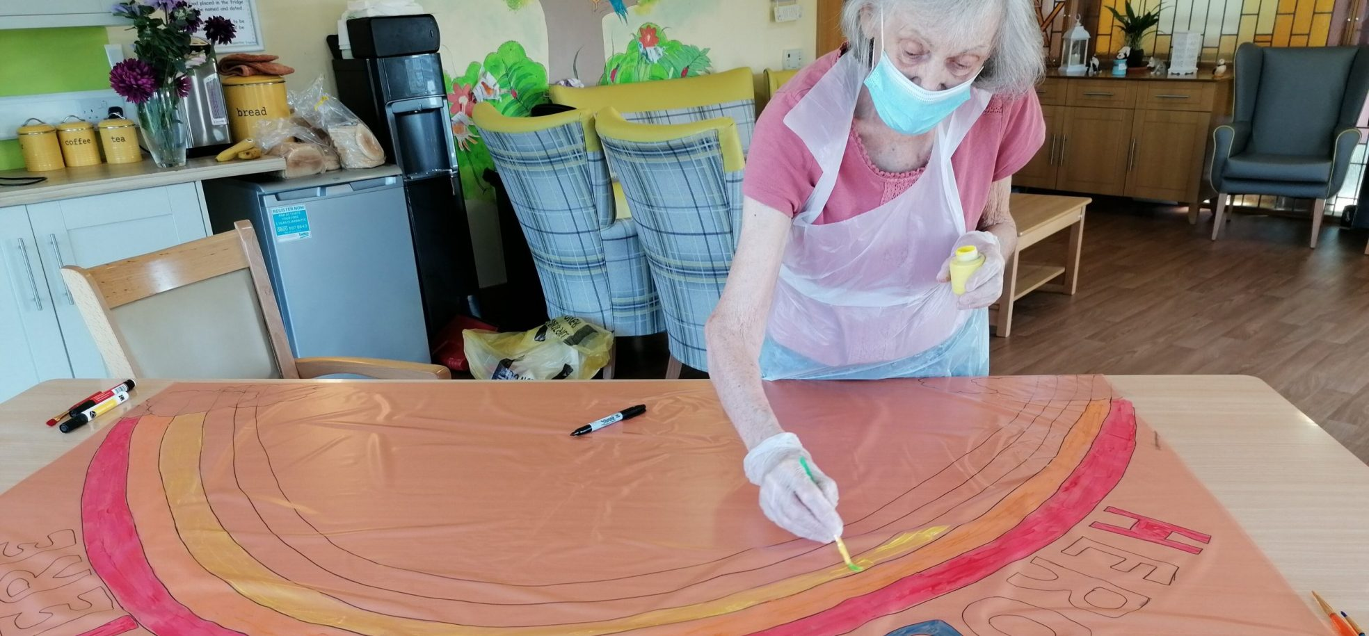 Scarbrough Court resident paints a rainbow picture to support care workers