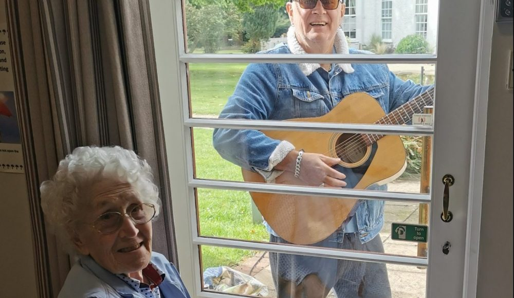 Local musician Pete Brill performs for delighted resident Betty