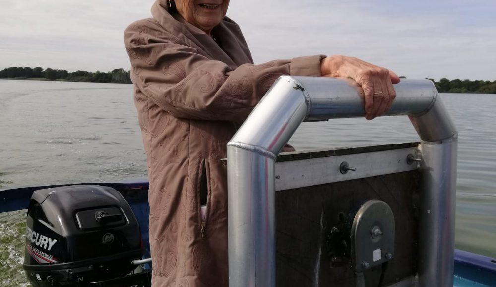 Josie steering the boat on Hornsea Mere