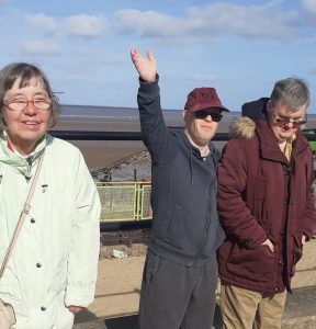 Residents' Denise Broadbent, Lee Balmer and Mark Nicholls enjoy a day trip to the local beach, following new government guidanc