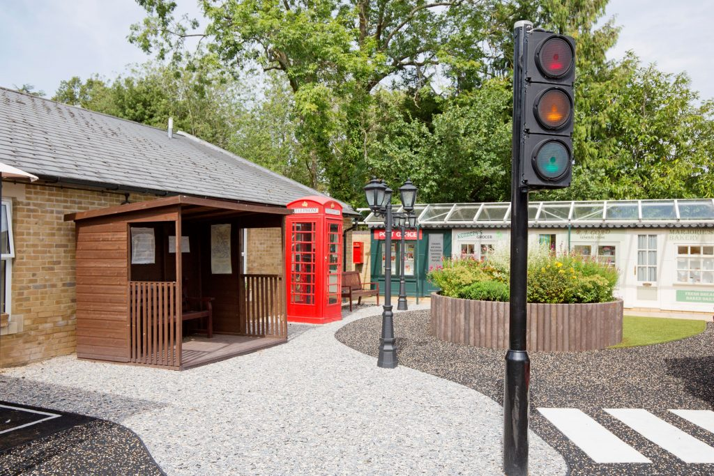 Reminiscence street, designed to stimulate residents living with dementia and enhance a sense of wellbeing, at Prince Michael of Kent Court in Watford, one of three 'Outstanding' CQC rated Homes at RMBI Care Co.
