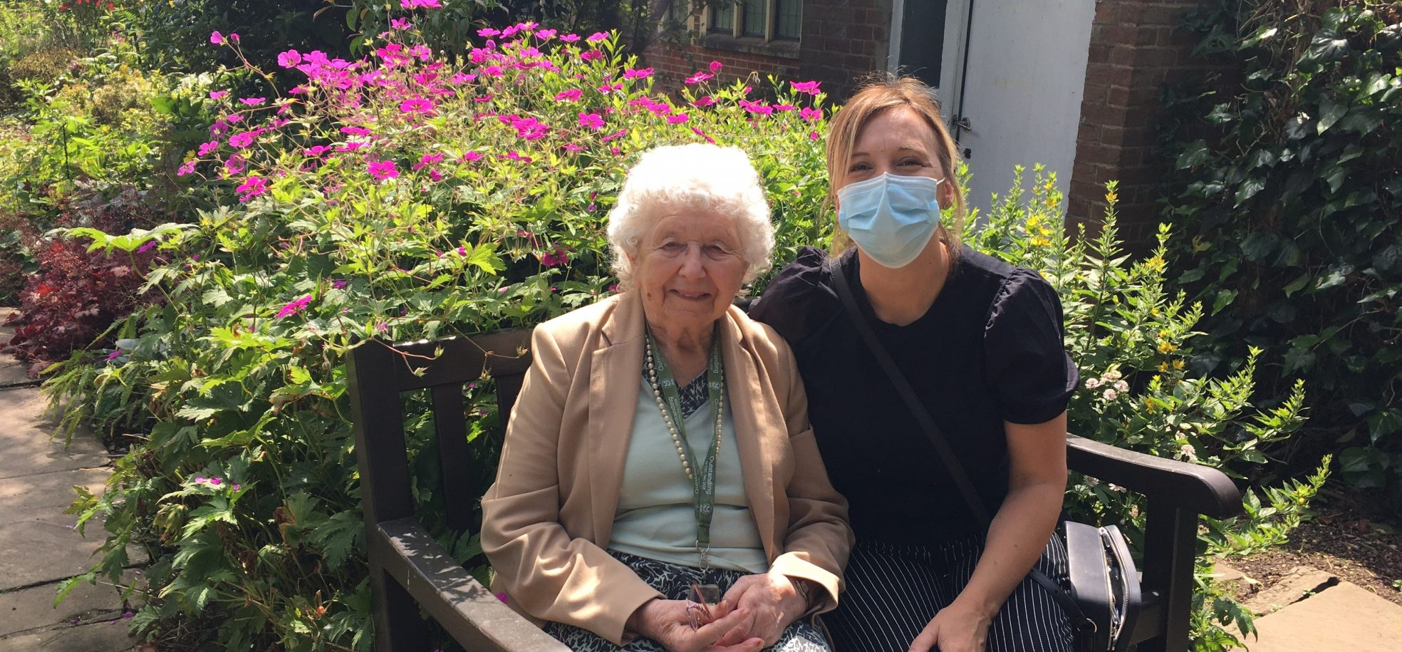Resident Jill Holbrook enjoys the outdoors with Tracy Lydon, one of the Home's Activities Coordinators.
