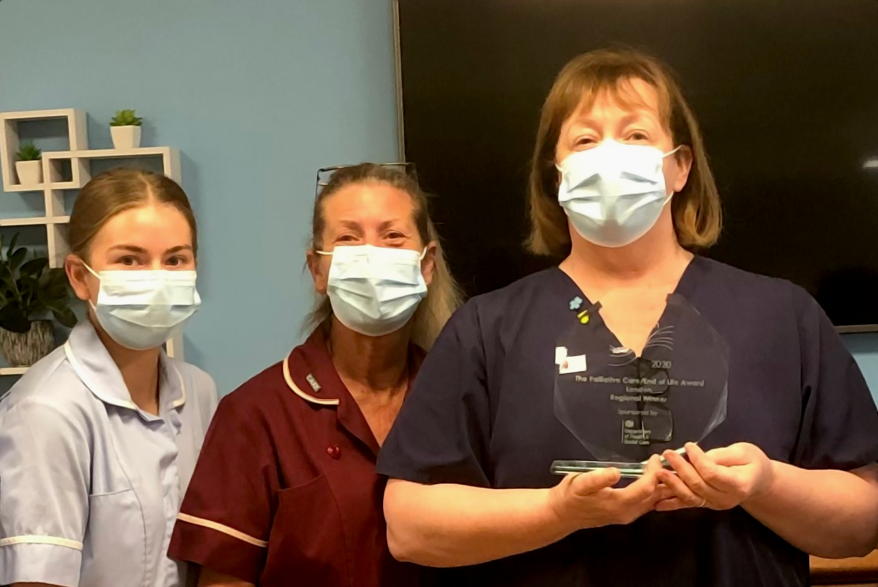 Clinical Lead Kim Fletcher holds her award while celebrating with staff members Pauleen Wickes and Amber Tarleton at Prince George Duke of Kent Court.